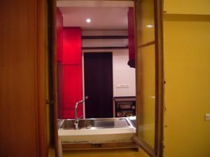 Fenêtre conservée entre la chambre et la cuisine